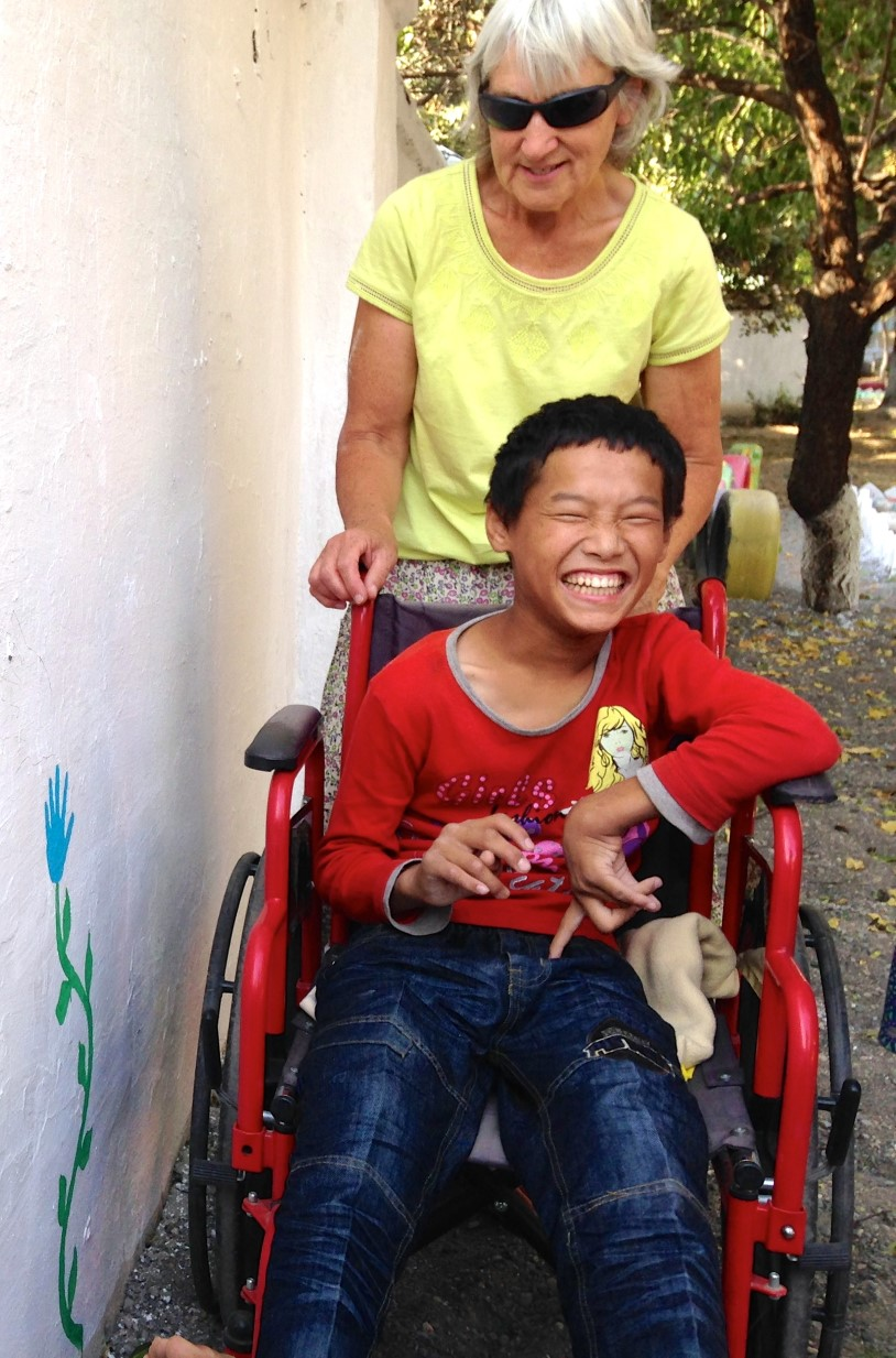 2015-01-06-SNC-in-Wheelchair-Laughing-story